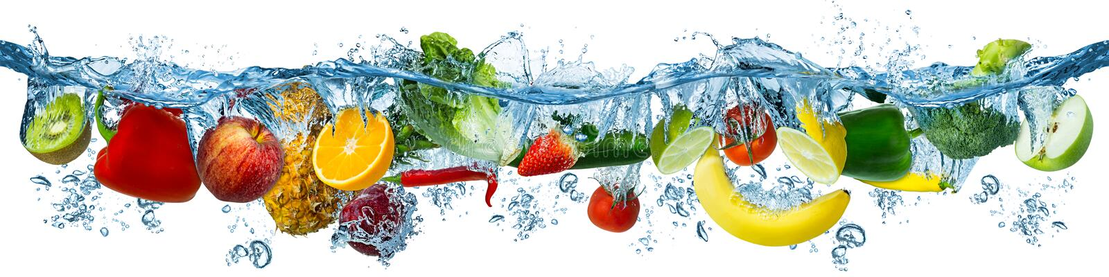 Fresh multi fruits and vegetables splashing into blue clear water splash healthy food diet freshness concept isolated white stock photo