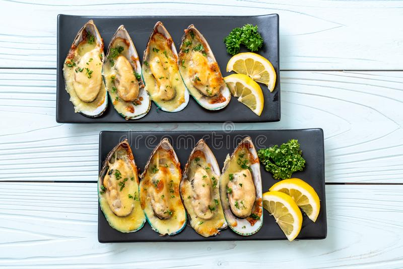 Mussel baked with cheese. Fresh mussel baked with cheese stock images