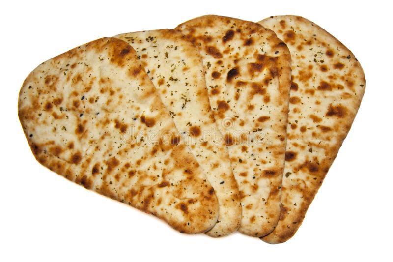 Fresh naan bread. Four fresh naan bread isolated over white royalty free stock photos
