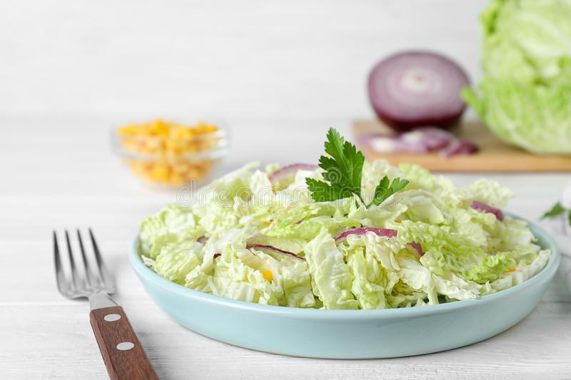 Fresh napa cabbage salad served on white table. Closeup royalty free stock photos