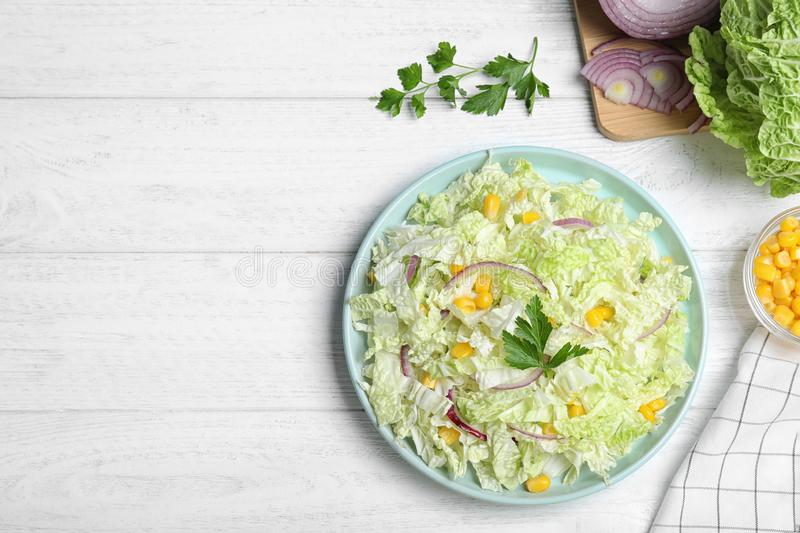 Fresh napa cabbage salad served on white table, flat lay. Space for text. Fresh napa cabbage salad served on white wooden table, flat lay. Space for text stock image