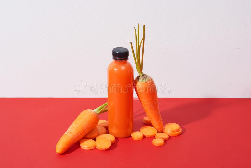 Fresh natural carrot juice on table. Healthy drink. stock photography