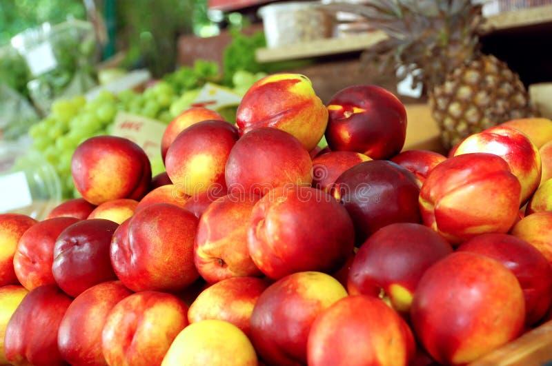 Fresh nectarines. Pile of nectarines sold on the market stock photos