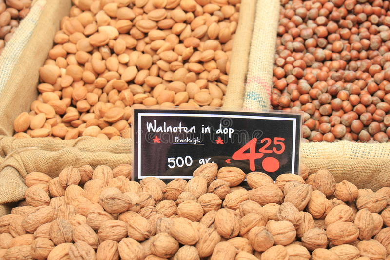 Fresh nuts on a market stall stock image