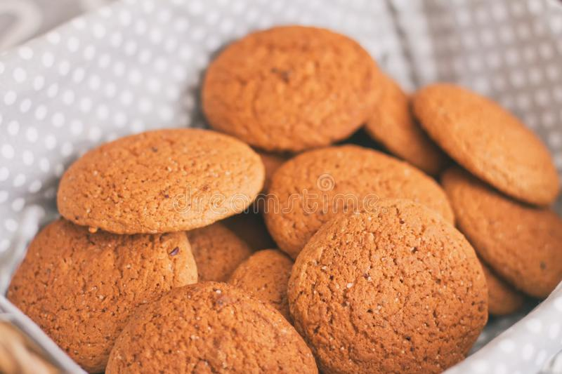 Fresh oatmeal cookies on light-colored fabric stock photography