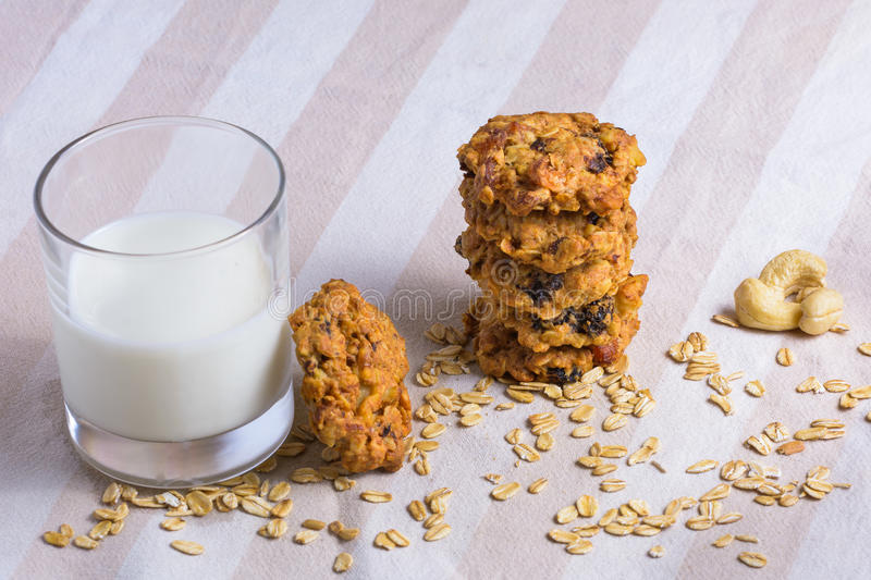 Fresh oatmeal cookies with milk stock image
