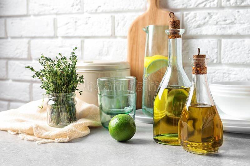 Fresh olive oil and kitchen utensils. On table stock images