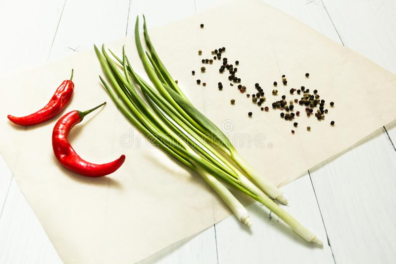 Fresh onions and peppers on a white background stock images