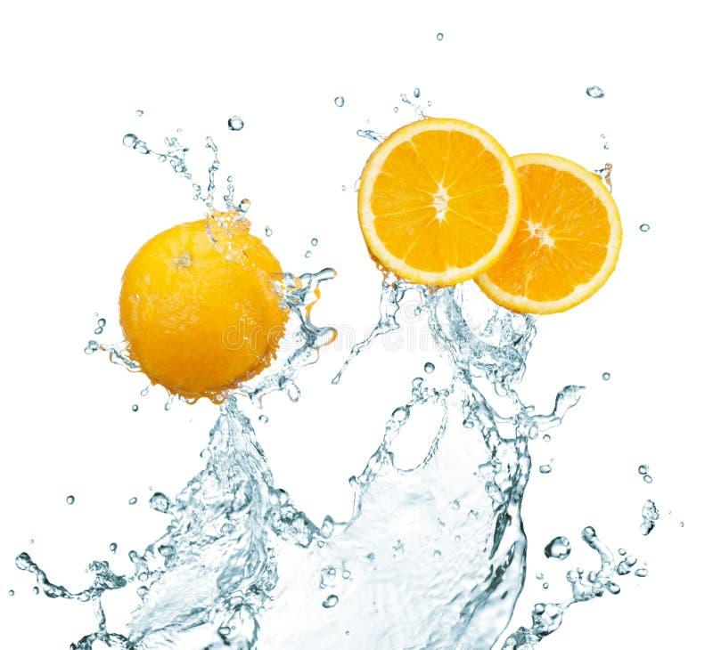 Fresh orange. With water splash on white stock photos