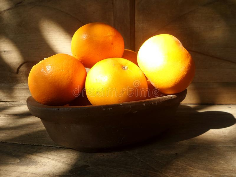 Fresh orange basket on wooden table stock photography