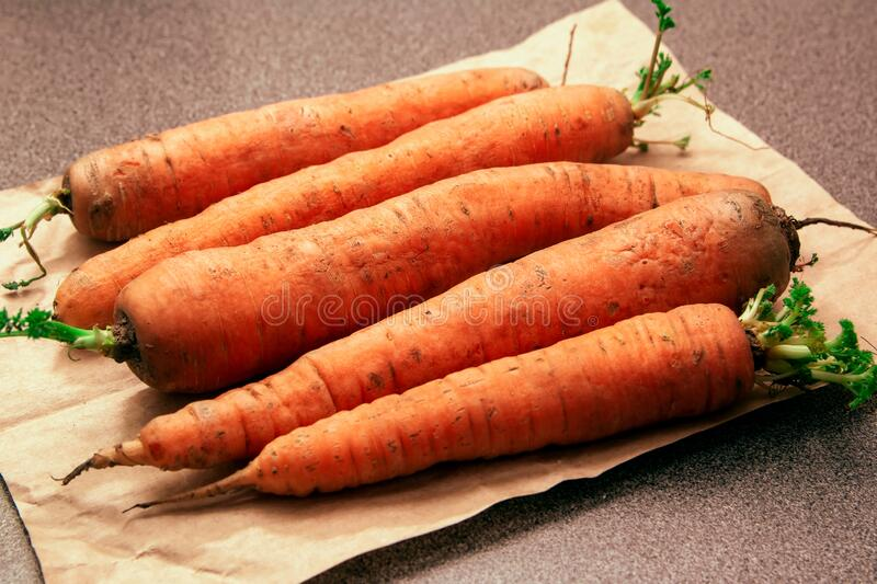 Fresh orange carrots on a wooden table stock photos