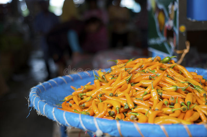 Fresh orange chili pepper at a street market