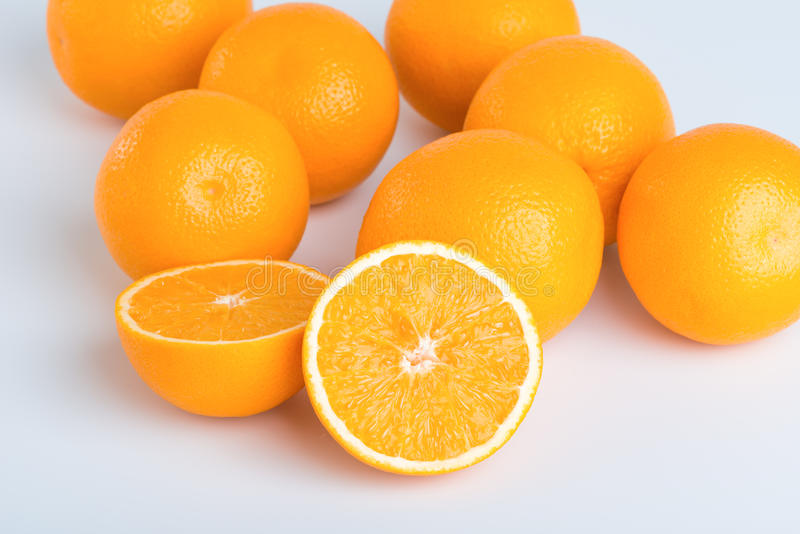 Fresh orange and cut in half. On white background royalty free stock photography