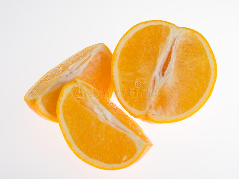 Fresh orange and cut in half. On white background royalty free stock images