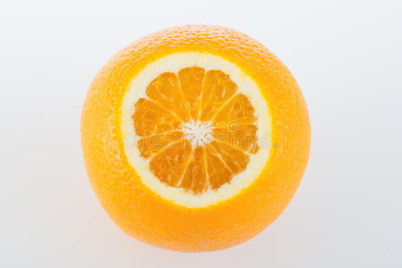 Fresh orange and cut in half. On white background royalty free stock image
