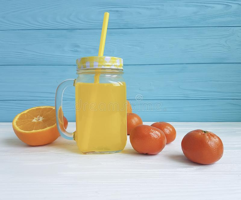Fresh orange fresh clear kitchen with straw morning white and blue wooden, mandarins. Fresh orange fresh clear morning straw from white and blue wooden mandarins stock photo