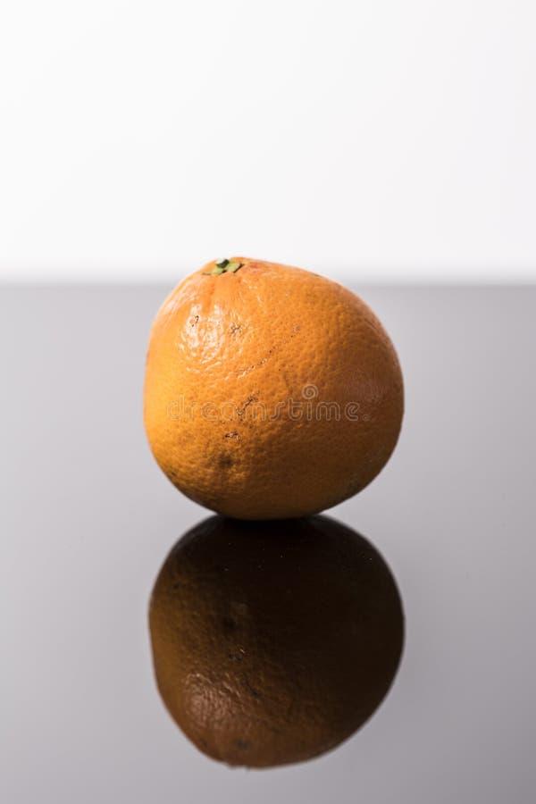 Fresh orange fruit close up  on a black and white background stock photography