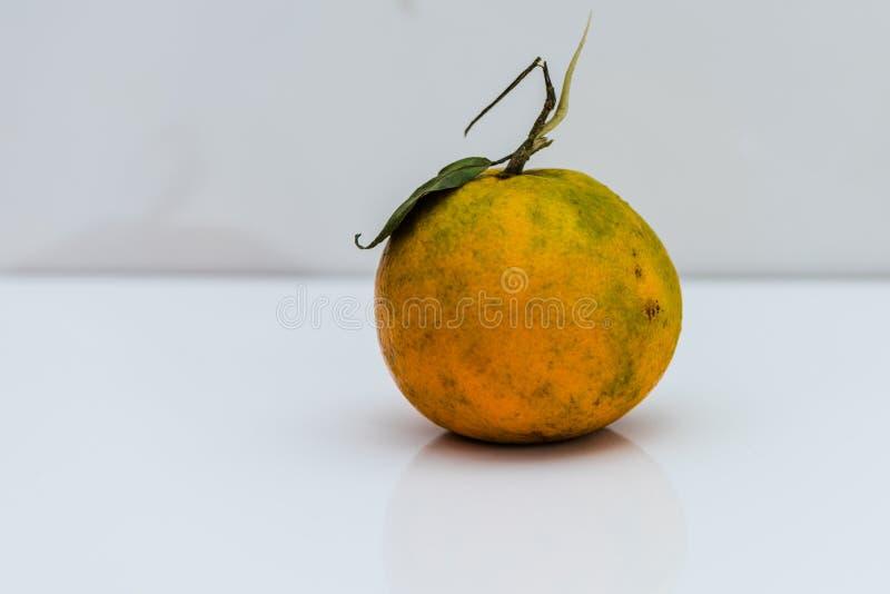 Fresh Orange fruit with green leaf. Fresh Organic Orange fruit with green leaf isolated on white background royalty free stock photo