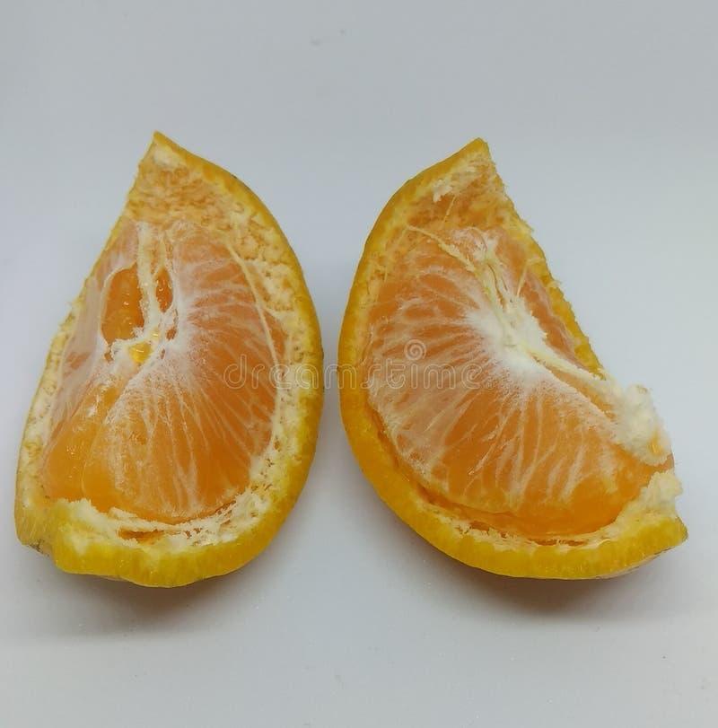Fresh orange fruits with peels royalty free stock image
