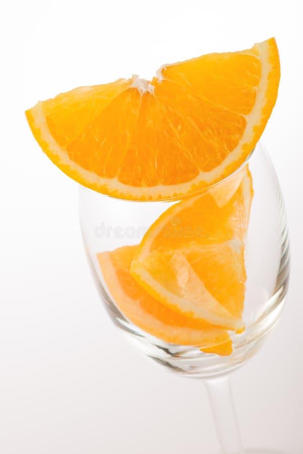 Fresh orange in glass. On white background stock photography