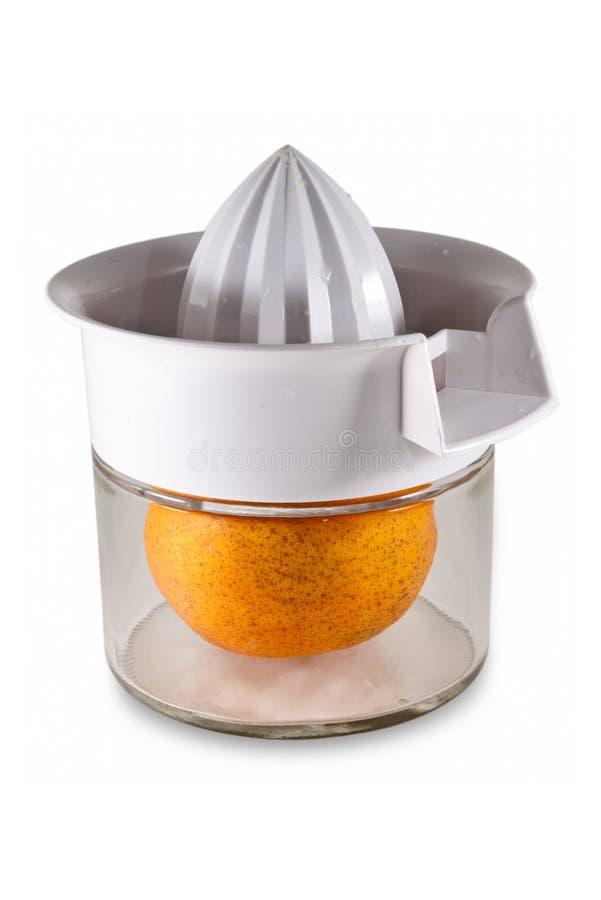 Download Fresh Orange Inside Juicer stock photo. Image of isolated - 7397638