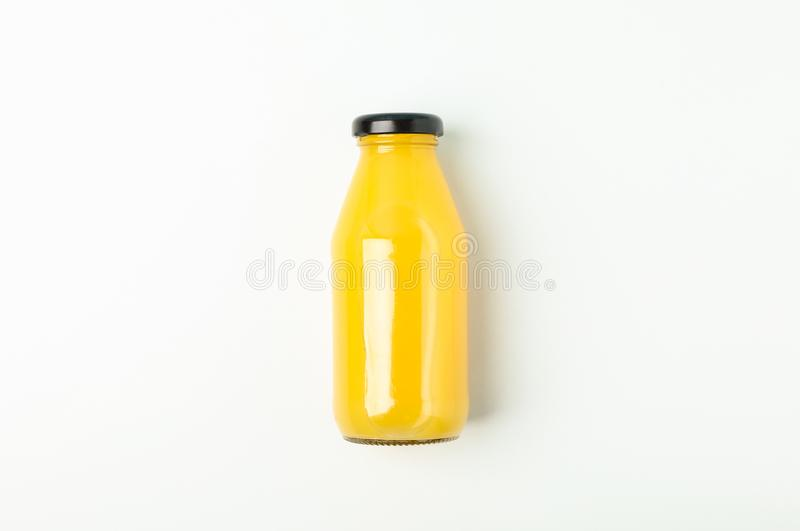 Fresh orange juice in bottle on white background, space for text. Fresh natural drink royalty free stock photo