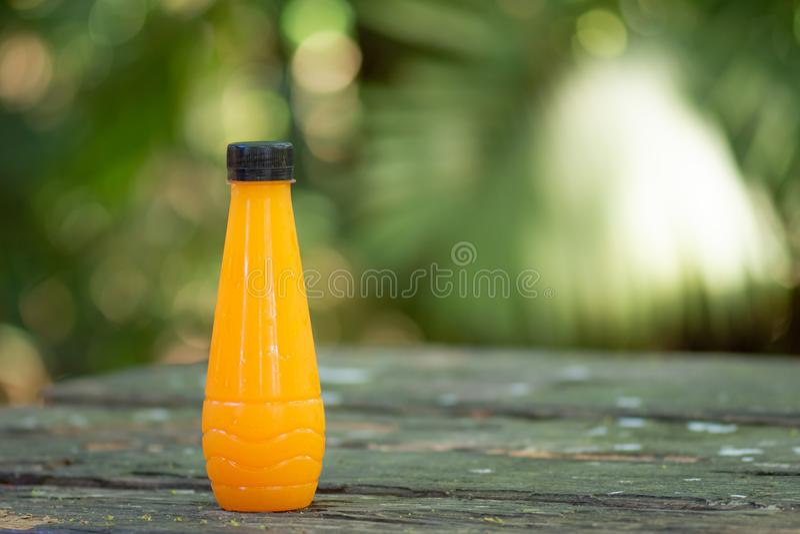Fresh orange juice in bottles on table. stock photography