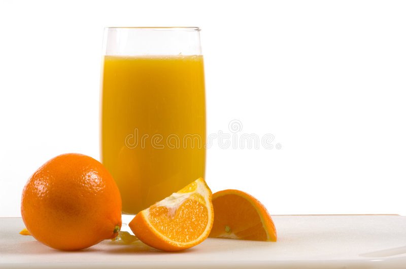 Fresh orange juice with fresh oranges stock photography