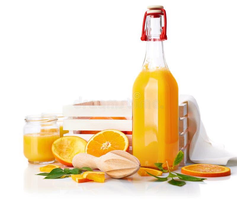 Fresh orange juice with fruit and green royalty free stock photo