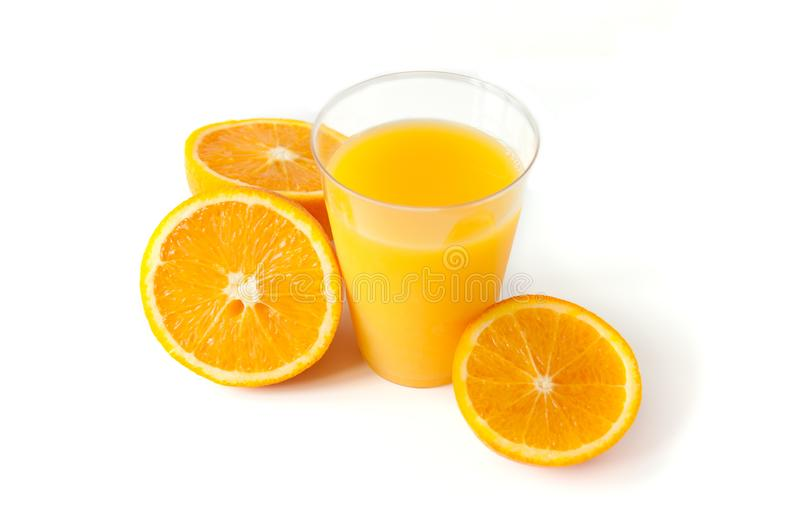 Fresh orange juice in a glass. Round orange slices on a white background. Citrus tropical fruit background. Bright food. stock photography