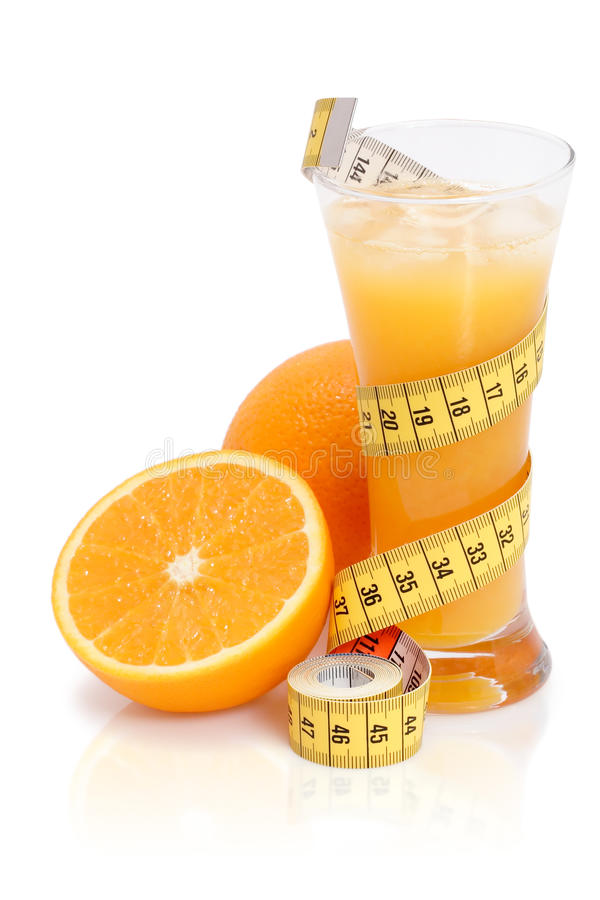 Fresh orange juice with measuring tape stock image