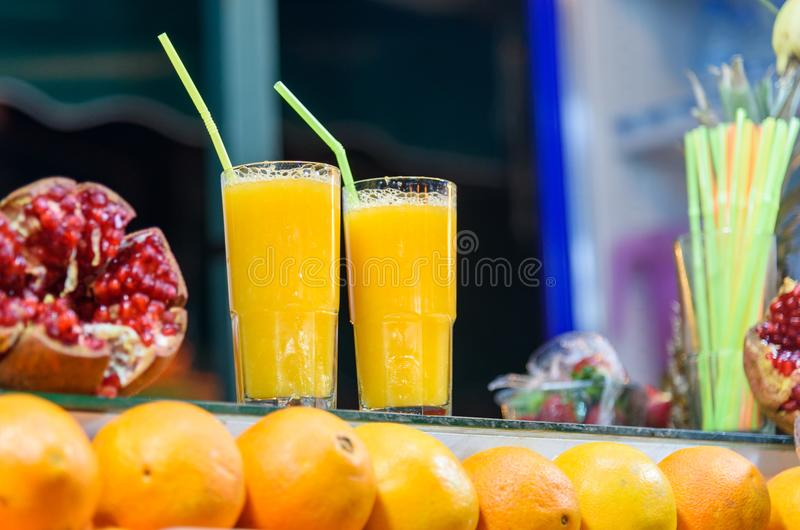 Fresh orange juice for sale in stall in Jemma El Fna square. Marrakech, Morocco. Fresh orange juice for sale in stall in Jemma El Fna square at nigh. Marrakech stock images