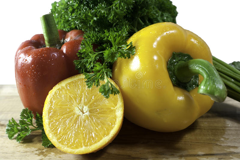 Fresh orange parsley and bell pepper royalty free stock photography