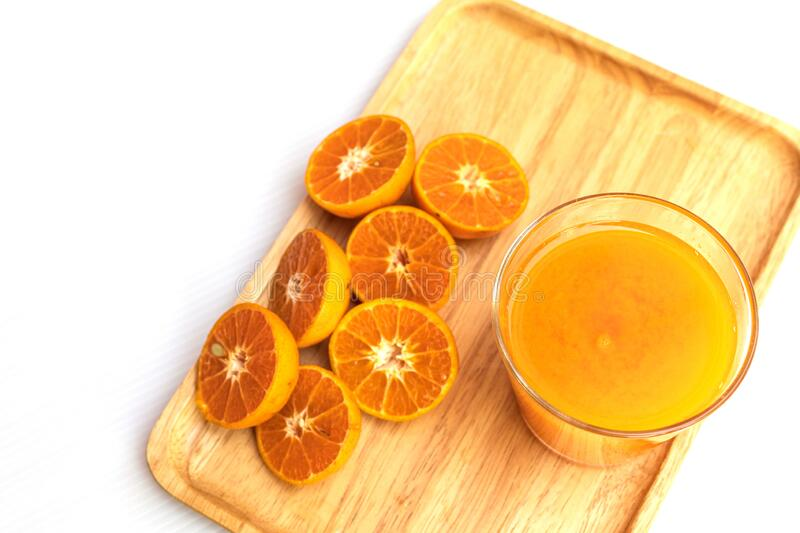 Fresh orange and pure orange juice in glass and bottle for good healthy royalty free stock image