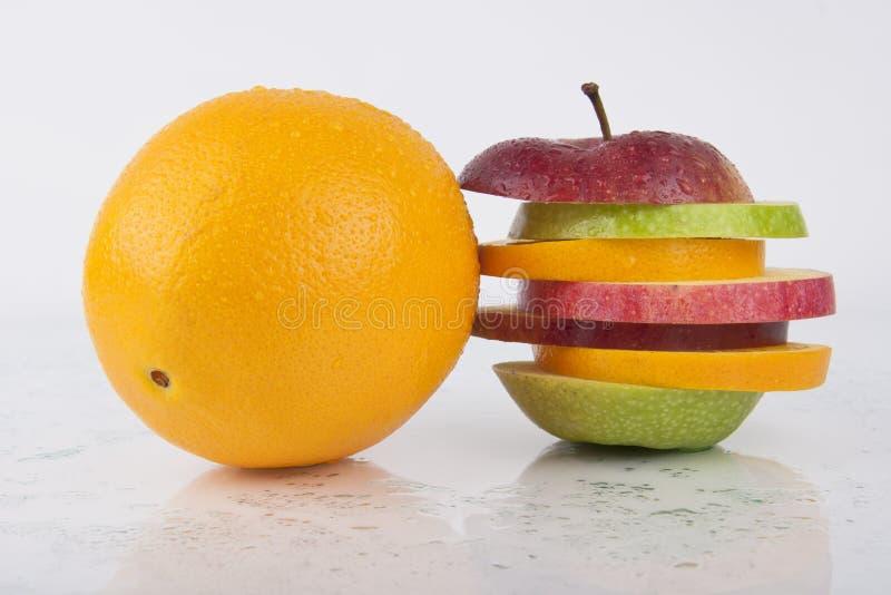 Fresh Orange and Sliced Fruit royalty free stock image