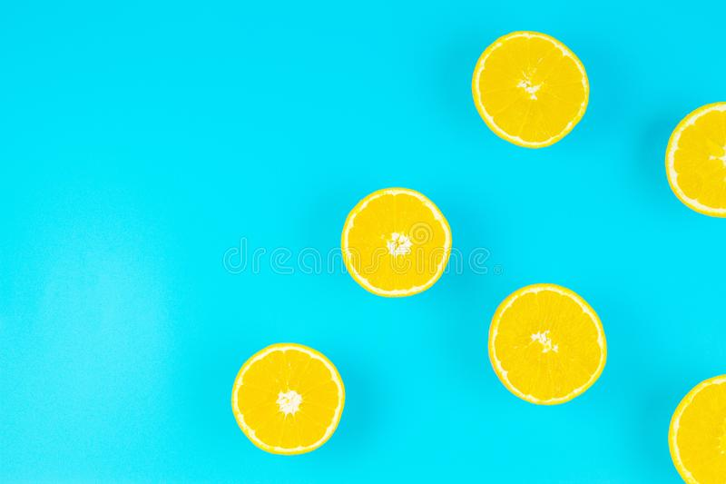 Fresh orange slices on light blue background, top view royalty free stock image