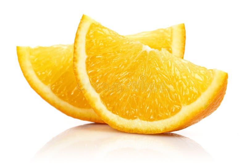 Fresh Orange slices isolated on white stock images