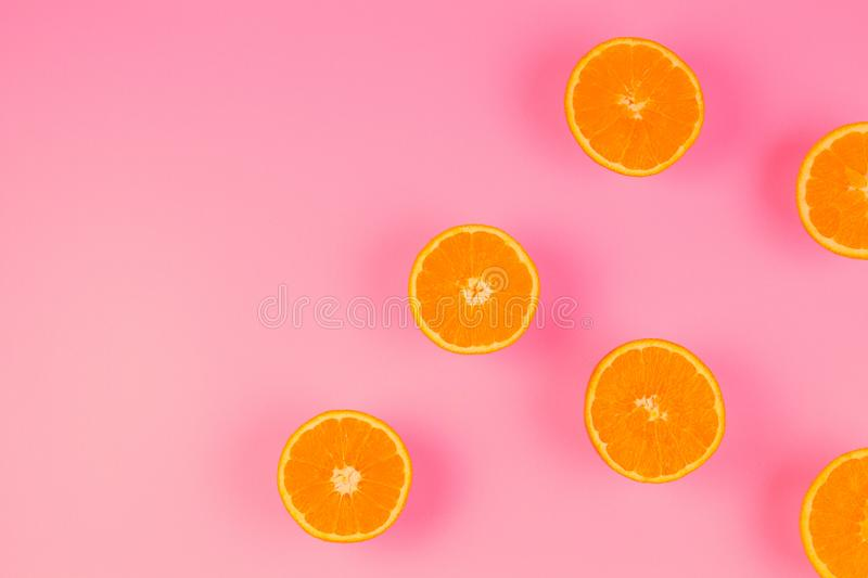 Fresh orange slices on pink background, top view royalty free stock photos