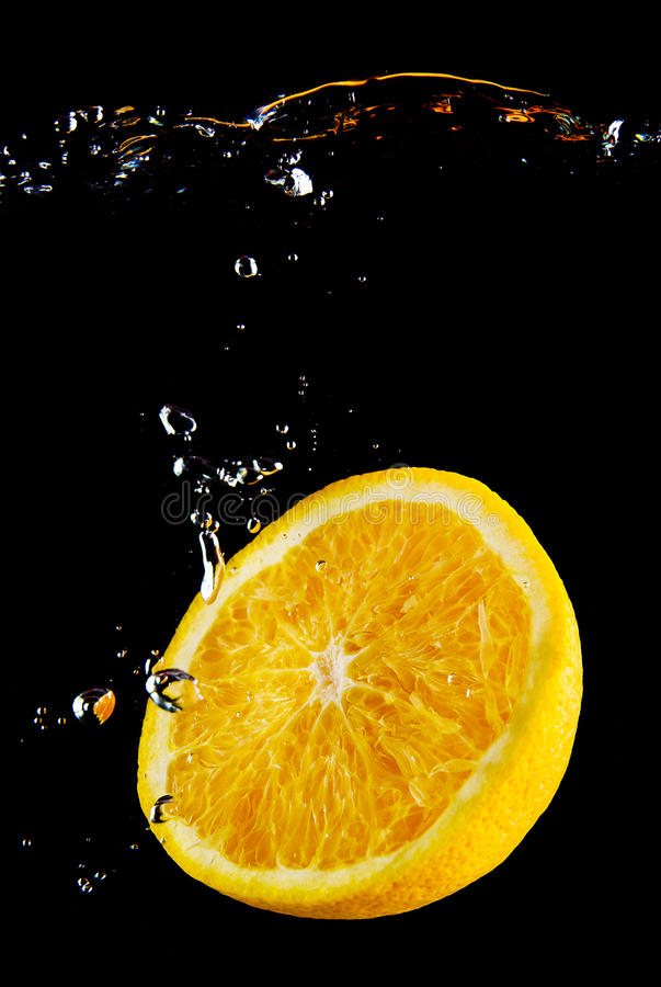 Fresh orange in the water stock photos