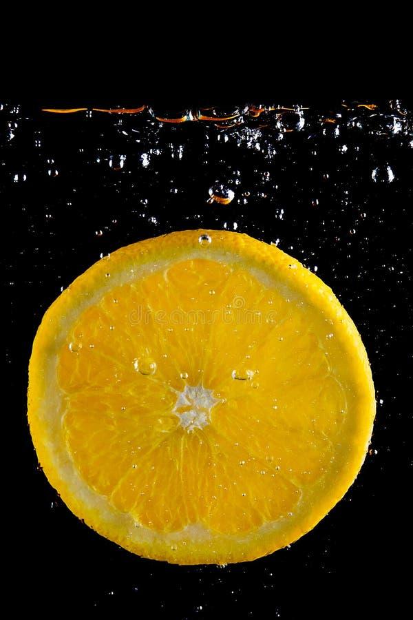 Fresh orange in the water stock photo