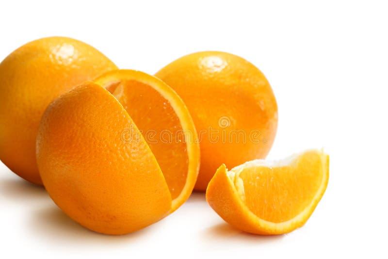 Fresh Oranges. Isolated on white stock images