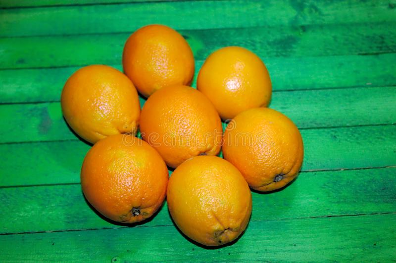 Fresh oranges on green boards. The picture shows fresh oranges on green boards royalty free stock image
