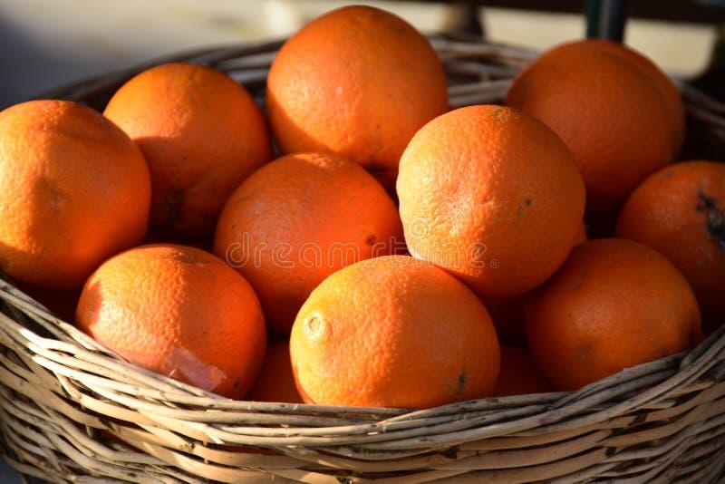 Fresh oranges group on basket from market. Background royalty free stock image