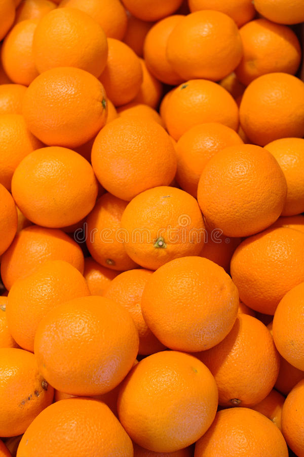 Fresh oranges. Multiple fresh oranges ready to be consumed stock photos