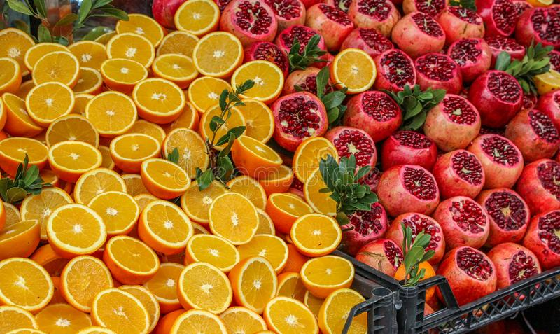 Fresh oranges and pomegranates royalty free stock photo