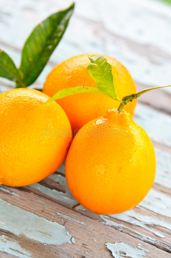 Fresh oranges on a table stock image