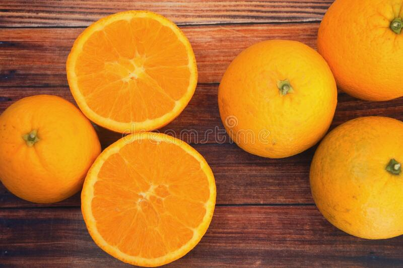 Fresh oranges on wooden background stock photo