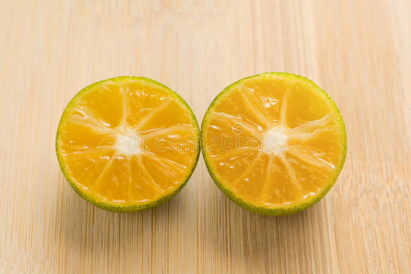 Fresh oranges on a wooden background stock photography