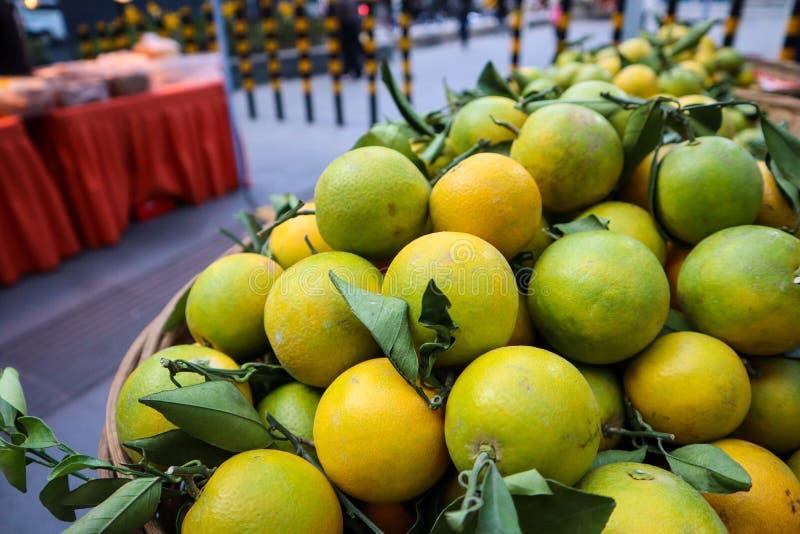 Fresh oranges in wooden basket royalty free stock image