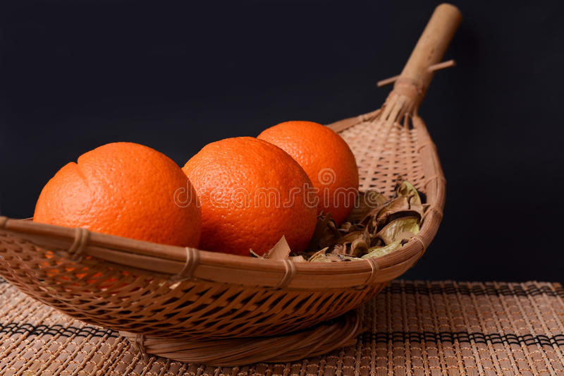 Fresh oranges on wooden dishes royalty free stock photo